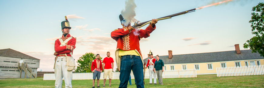 battle reenactment with muskets